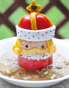 """""""King Curry"""" - King made from onigiri/rice, red pepper, sliced egg sheet, and cheese!"""