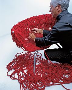 Vermelha, an armchair designed by Fernando and Humberto Campana for Edra, 1998. An expert weaver takes four days to build it, using 500 meters of special rope with an acrylic core and covered in cotton