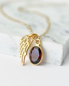 Miscarriage Jewelry - Gold Angel Wing Necklace with January's Birthstone garnet.  Miscarriage gifts / Stillborn / Pregnancy Loss