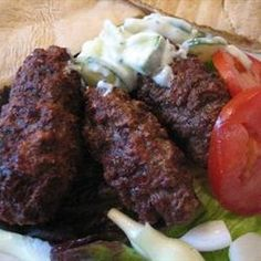 Serbian Cevapcici-made tonight with beef & lamb. Everybody liked it and on the table start to finish in 45 minutes-baked at 350 on roaster pan. Yum! Yum! Said my little boys asking for another!