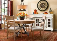Casual cottage charm—the delightful details of the Hope Isle 5-piece dining set are hard to resist. The table's weathered sand finish and silky wood grain create a carefree I'm-on-vacation feeling, and the curved and shaped pewter-finished metal base provides graceful support. Paired with comfortable padded linen-upholstered chairs, this set will keep you hanging around the dinner table long after the dishes are cleared.