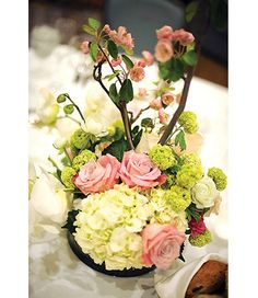 Japanese spring garden floral arrangement with apple blossom branches, faith roses, vivernum, white ranunculus & ivory hydrangeas