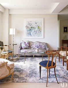 A Robert Harms painting overlooks the living room; the rug is by Fort Street Studio in Isaac Mizrahi's Manhattan home