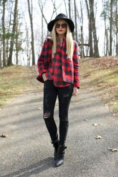 Take a cute from Blair Eadie and style a red plaid shirt with ripped black skinny jeans and boots