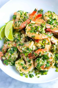 Garlic Butter Shrimp with Cilantro and Lime Easy garlic shrimp recipe made with garlic, cilantro, lime and butter sauce. Serve these delicious shrimp as an appetizer, over rice or in tortillas for tacos. Cilantro Recipes, Shrimp Recipes, Fish Recipes, Cilantro Shrimp, Buttered Shrimp Recipe, Garlic Butter Shrimp, Recipe For Butter Shrimp, Garlic Prawns, Buttery Shrimp