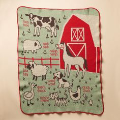 "RED BARN BLANKET -- This soft knit blanket has all the farm animals in place and in concert for cozy—and artful—learning. Made in USA of recycled cotton/acrylic. Machine wash. 30""W x 40""H."