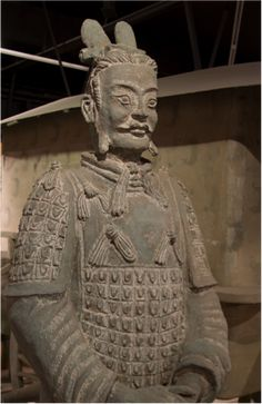 China starts new terracotta army dig - Archaeologists plan to excavate about 200 square meters of Pit 2, located near the tomb of Emperor Qinshihuang, founder of the Qin Dynasty (221-206 BC). Archaeologist Yuan Zhongyi estimated that the burial pit has 1,400 clay figures and horses and 89 chariots waiting to be unearthed. Pit 2 was previously excavated and several coloured warriors, including a rare specimen with a green face, were unearthed / Terracotta Warrior. ©Tony Hisgett