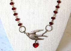 Swallow Necklace Faceted Ruby Glass Heart. $30.00, via Etsy.