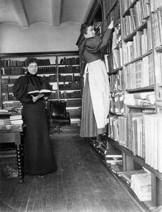 Wisconsin Historical Society librarians in the stacks, 1896.  This week, Wisconsin Heritage Online celebrates National Library Week with historic photographs of Wisconsin librarians at work. This 1896 image of Minnie Oakley and Florence Baker Hayes was taken in the Wisconsin State Capitol building, which housed the Wisconsin Historical Society library and archives from the 1860s until 1900.  via: Wisconsin Historical Images, Wisconsin Historical Society