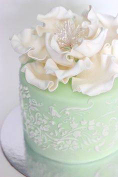 Gorgeous mint and cream peony stencil cake. #wedding #cakes #flowers #mint_green