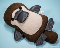 Platypus plush - Duck-Billed Platypus stuffed animal - PlatyBon Meet PlatyBon the Platypus. She loves candy and chocolate bonbons. She dreams of becoming a pastry chef one day. Her best friend is Plat