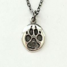 Tiny Wolf Track Necklace in Sterling Silver Wolf Paw Track Pendant... ($56) ❤ liked on Polyvore featuring jewelry, necklaces, sterling silver charms, wolf jewelry, sterling silver pendant necklace, wolf pendant necklace and pendant necklace