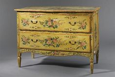 AN ITALIAN YELLOW AND POLYCHROME-PAINTED AND PARCEL-GILT COMMODE  MID-18TH CENTURY AND LATER, LATER DECORATED  Decorated floral sprays throughout, with two long drawers, with a serpentine skirt, on tapered legs, loses to decoration