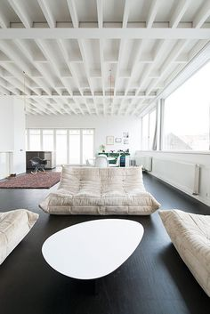 Deep, dark painted floors with bone white walls.