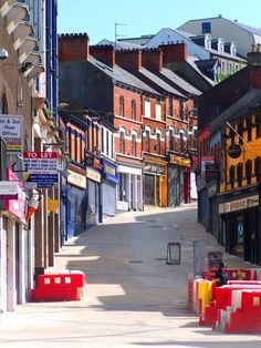 Streets in the City of Derry, Northern Ireland ... this pic must have been taken early on a Sunday morning before mass or church ... shutters down and not a person in sight