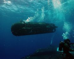 PHOTOS: Inside The Secret World Of Navy Seals A US Navy SEAL Delivery Vehicle (SDV) moves away from a submarine onto its target as shown in the newly release coffee table top book, US Naval Special Warfare / US Navy SEALs.