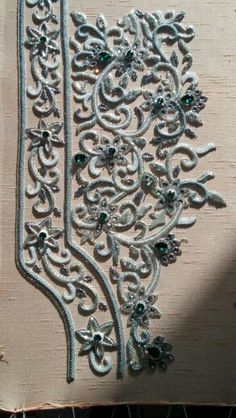 Green stone on silver work