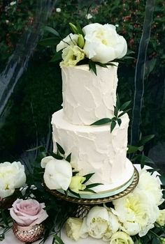 Breathtaking two tier white textured wedding cake with green details; Featured Cake: The Cake & The Giraffe