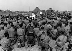 The Seabees of the 111th Naval Construction Battalion give thanks in Normandy, France on Thanksgiving, 1944.