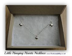 Hey, I found this really awesome Etsy listing at https://www.etsy.com/uk/listing/537039481/little-hanging-hearts-necklace