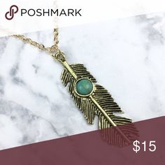 """Gold feather turquoise necklace boho Measures 16-18"""" and is made of metal alloy acrylic stone. Smoke free, cat friendly home. Photo courtesy of Wila. wila Jewelry Necklaces"""