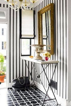 Much like a striped sweater, this print never goes out of style in home decor. For a classic and chic look, try black and white stripes or navy for a nautical-inspired room.