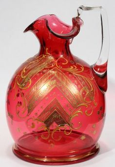 cranberry pitcher with applied crystal handle, gold enamel