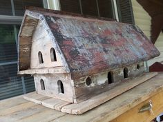 BARN BIRD HOUSE WITH OLD TIN ROOF.