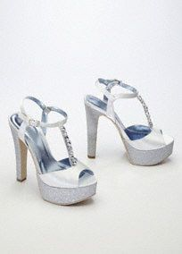 """Feel like Cinderella way past midnight, in these gorgeous glitter platform sandals!  Sandals feature super platform and glitter detailing.  Rhinestone embellished t-strap adds a touch of drama to this already fabulous shoe.  5 1/4"""" heel. 1 1/4"""" platform.  Available in Champagne and White. Imported."""