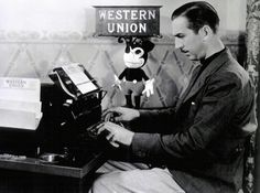 Walt Disney at another typewriter, early 1930s. Photo by Gunnar Andreassen