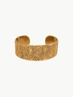 Brass cuff with a textured pattern with undulating bursts. Inspired by California pottery.Of A Kind