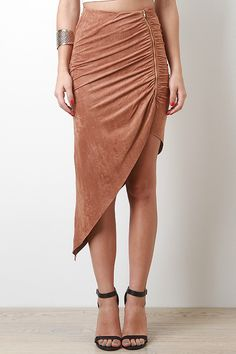 This suedette maxi skirt features a hidden elasticized waist, ruched detailing at side zipper fastener, and a diagonal hemline. Accessories sold separately. 90% Polyester, 10% Spandex.  iloveBUDI.com