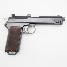 THE STEYR HAHN MODEL OF 1911: This pistol was popular with the Austro-Hungarian, Chilean and Romanian militaries before World War II and many were rebarreled by the Germans during the Nazi regime (after being adapted to the 9mm Parabellum cartridge). Some of the Romanian contract pistols were even imported to the United States. This semi-automatic pistol was loaded by stripper clip and holds an 8 round capacity; the pictured version bears the s/n 310 and is on display in our World War I…