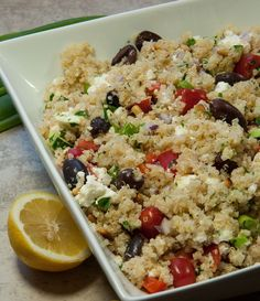 This Greek quinoa salad is filling, full of fresh flavors, and packed with nutrients with only 241 calories and over 8 grams of protein per serving - Feasting Not Fasting
