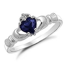 The claddagh is an Irish design that symbolizes love, loyalty, and friendship. A blue sapphire cubic zirconia heart dots the center of this claddagh ring. Jewelry is crafted of polished sterling silver. Claddagh Engagement Ring, Silver Claddagh Ring, Sterling Silver Rings, Engagement Rings, Bling Bling, Tutorial Anillo, Heart Promise Rings, Heart Ring, Hand Heart
