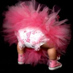 Cute picture idea to show off your little girls personalized 1st birthday bloomers.  See more first girl birthday party ideas at www.one-stop-party-ideas.com