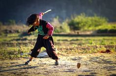 Playing traditional game (Mong ethnic)