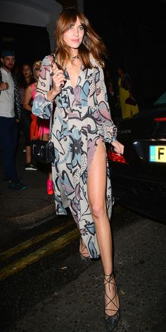 Alexa Chung in a printed dress, black bag, and heels