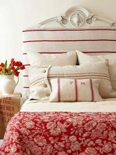 To me, this shows how decorating a bedroom with 'red' is so non-intimidating, with a pleasing-to-the-eye soft red  cream.  Just lovely  Vintage hemp grain sacks.