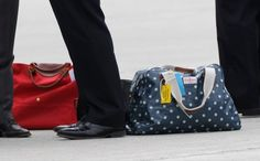 Polka dot carry-on luggage. Brilliant!