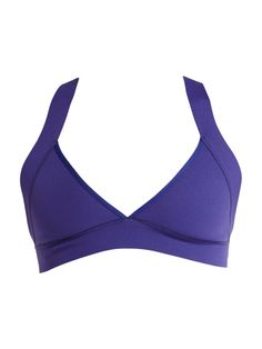 Roxy, Wave Ready Swim Top. Bikini looks, wetsuit warmth and security. This performance surf top is made with a 1mm neoprene fabric in a cut that shows off your curves and allows unlimited mobility. Wide crossover straps connect with an adjustable chestband in back for the perfect comfortable fit.  100% Nylon, 1mm Neoprene.  Hand wash cold. Imported.
