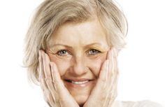 Mature woman holding her face