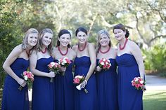 love this look for bridesmaids - strapless simple dresses with a bold necklace