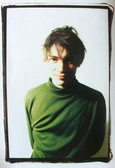 Color photograph, but still minimal color. Again, dark shadows. Alex James Blur, Blur Band, Celebrities Reading, Going Blind, Damon Albarn, Blur Photo, Jamie Hewlett, Britpop, Graham Coxon