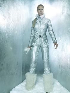 space fashion shoot. Silver boiler suit and fur boots. moon landing