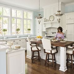 Site leads to other pictures of beautiful white kitchens.  I love the window and counter space in this one.
