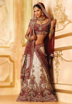 BW82 Off-white & Maroon Lehenga PANETAR A very rich panetar bridal in white bandhani skirt beautifully embroidered in zardozi, stones, gold work in ornate pattern with an attached drape dupatta border all sides held with a brocade on the shoulder, wo