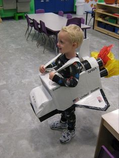 cute costume the shuttle costume from boxes, tape, disposable cups and tissue paper.