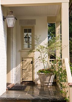 Portico floor, wall mount lantern, potted tree or plants