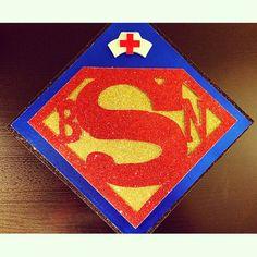Superman and nursing graduation cap